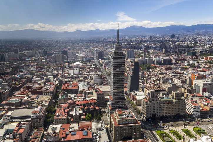 torre latinoamericana on avenida juarez with ajusco mountainrange in the back
